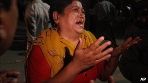 A Pakistani woman mourns her two missing sons