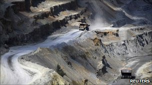 Tipper trucks transport a load at the copper mine plant in Serbian town of Bor