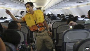 Male air crew dancing on Cebu pacific plane 8 oct 2010
