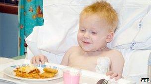 A boy eating food in hospital