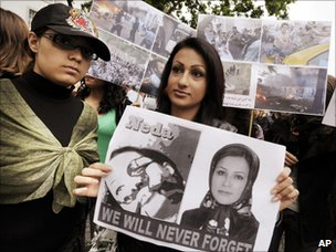 People of Iranian descent hold images of Neda Agha-Soltan at a protest outside the Iranian embassy in Zurich, Switzerland (24 June 2009)