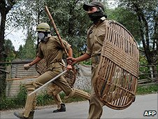 (Photo from 8 September 8, 2010) Police chase demonstraters in Srinagar