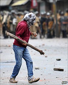 (Photo dated from 10 September, 2010) A protester prepares to throw a missile at police in Srinigar