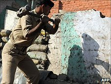 An Indian paramilitary soldier demolishes a security bunker in Srinagar