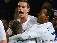 Jordan Henderson (centre) celebrates his goal against Romania