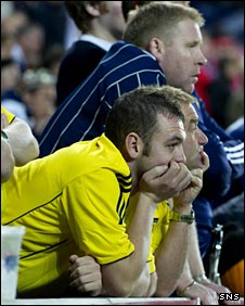 Disillusioned Scotland fans look on in Prague