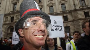 Scientists gather outside the Treasury in London to protest government cuts to science