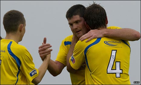 Derek Holmes (centre) celebrates his goal against Peterhead