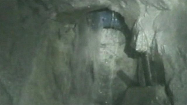 Drill passing into miners' chamber