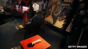A woman surveys Michael Jackson memorabilia at the Hollywood Legends auction