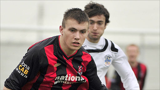 Stuart Dallas of Crusaders in action against Mark Patton of Lisburn Distillery