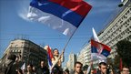A boy waves the Serbian flag in Belgrade