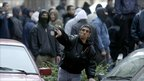 A man throws a rock at police at an anti-gay demonstration in Belgrade