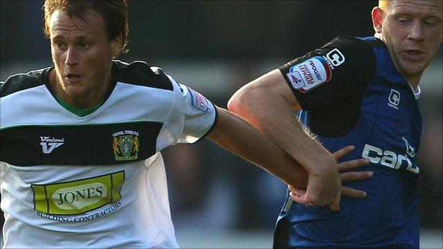 Sam Williams of Yeovil (left) holds off Jason Kennedy of Rochdale