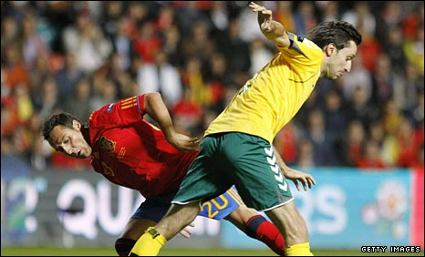 Santi Cazorla (left) in action against Lithuania