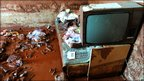 A television in a house damaged by red mud in Kolontar (10 Oct 2010)