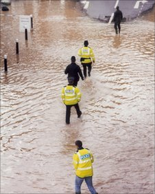 Police paddling through flood waters