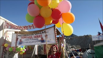 Rony the clown ties balloons to the entrance to Camp Esperanza (file photo)