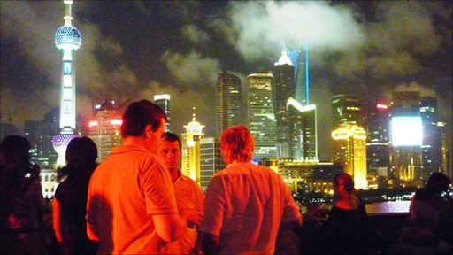 Drinkers on the terrace at Bar Rouge, with a view of Pudong behind them