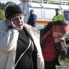 People crying near the scene of the crash near Marhanets, Ukraine