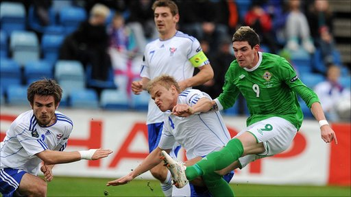 Northern Ireland striker Lyle Lafferty gets a shot in against the Faroe Islands