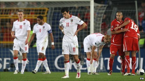 Gareth Bale (centre) is left dejected following Wales' defeat