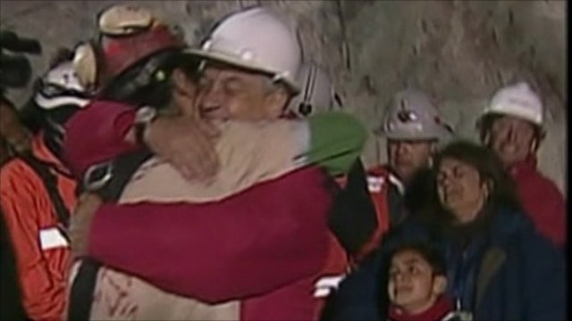Chilean President Pinera hugs rescued miner
