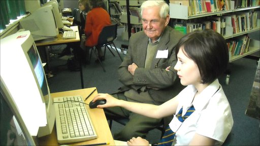 Elilidh, 12, shows her grandfather Lawrie, 82, how to find what he's looking for on the internet