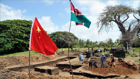 A Chinese and a Kenyan flag flutter above the excavation site
