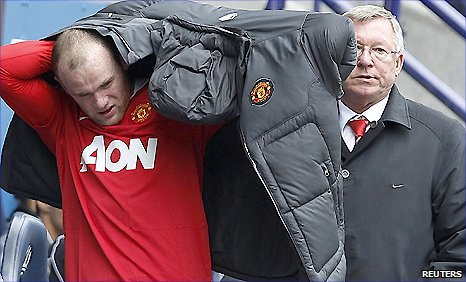 Man Utd striker Wayne Rooney (left) and manager Sir Alex Ferguson