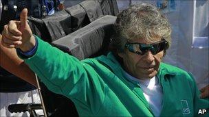 Rescued miner Mario Gomez gestures