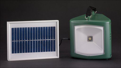 Solar-powered lamp with charger