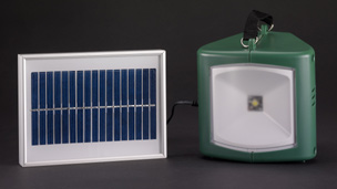 A solar-powered lamp and charger