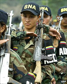 Female fighters of the Colombian United Self-Defence (AUC) right-wing paramilitary guerrillas parade before surrendering the weapons during a demobilisation ceremony. (File photo)