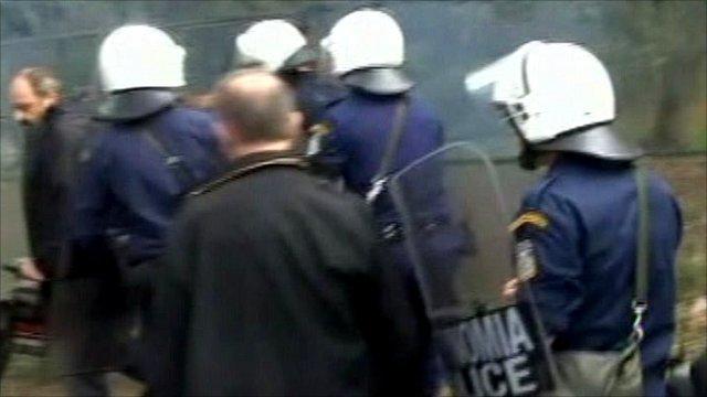Riot police enter the Acropolis site