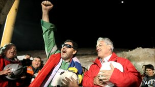 Chilean miner Luis Urzua celebrates with Chile's president Sebastian Pinera