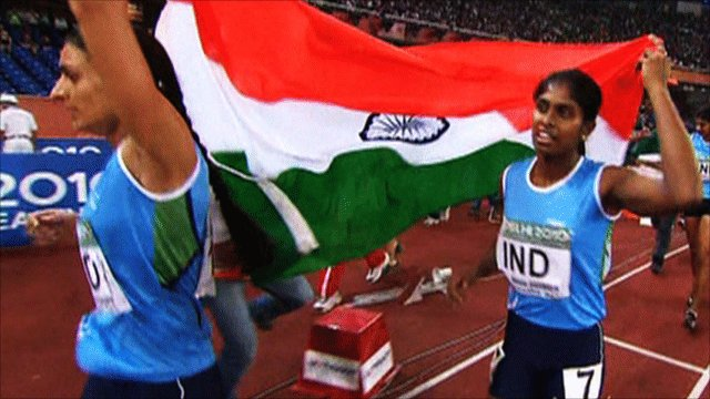 Athletes carry the Indian flag