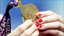 Rebecca Adlinton showcases her gold medal - and painted nails