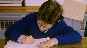 Child writing at desk