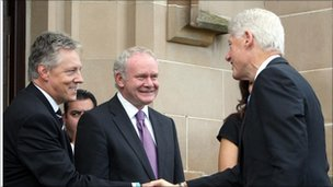 Peter Robinson and Martin McGuinness greet Bill Clinton