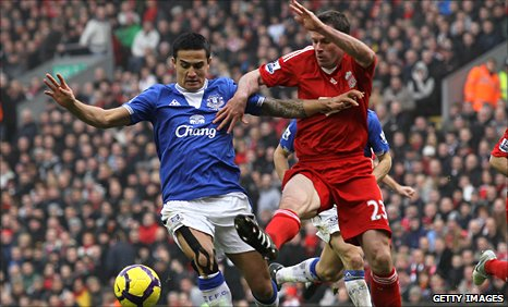 Tim Cahill and Jamie Carragher