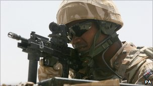 A soldier looking through his rifle scope during a patrol in Lashkar Gah, Afghanistan (file pic: 2009)