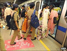 Women boarding a 'Women only' carriage