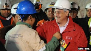 Chilean President Sebastian Pinera greets a miner at the San Jose mine, (13 Oct 2010)