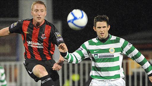 Chris Morrow of Crusaders in action against Donegal Celtic of Darren McNamee