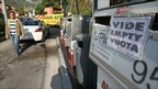 A sign tells motorists that the fuel pump is empty in a gas station in Nice, 15 October