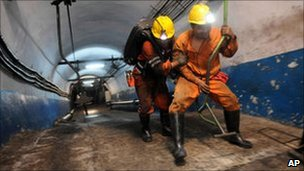 Rescuers prepare to go underground after the leak at the mine in Yuzhou