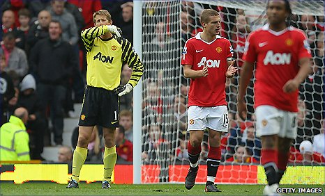 Edwin van der Sar (left) reacts after his error gifted West Brom an equaliser