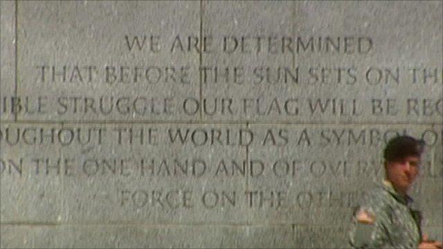 Soldier with war memorial