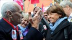 Lille mayor and first secretary of the Socialist Party, Martine Aubry, talking to a demonstrator in Lille (16 October 2010)
